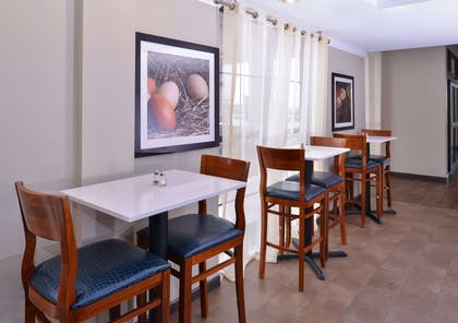 Enjoy breakfast in this seating area | Comfort Suites near Westchase on Beltway 8