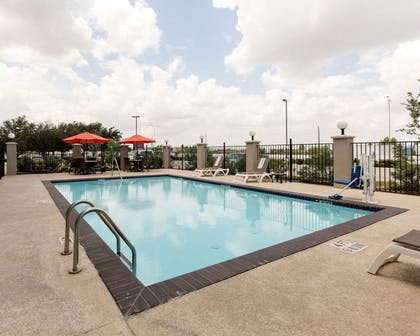 Outdoor pool with sundeck | Comfort Suites near Westchase on Beltway 8