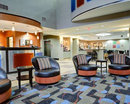 Spacious lobby with sitting area | Comfort Suites Bastrop