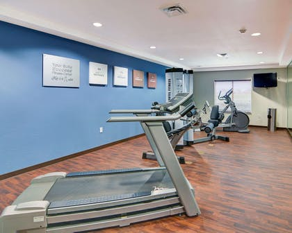 Exercise room with cardio equipment | Comfort Suites near Cedar Creek Lake