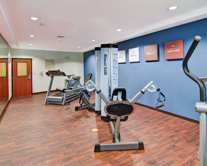 Exercise room with cardio equipment and weights | Comfort Suites near Cedar Creek Lake