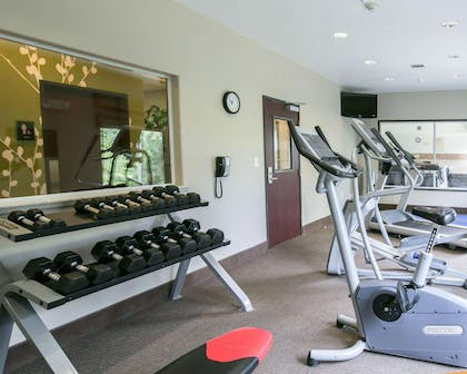 Fitness center with cardio equipment and weights | Sleep Inn & Suites Round Rock - Austin North