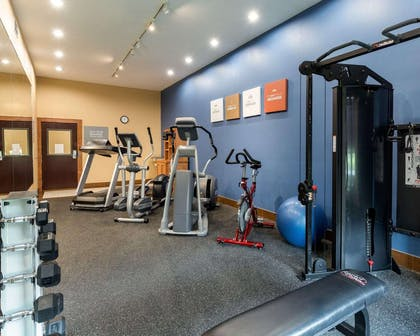 Fitness center with cardio equipment and weights | Comfort Suites at Katy Mills