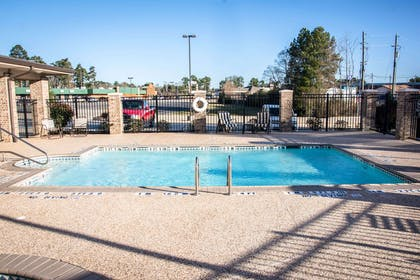 Outdoor pool with sundeck   Sleep Inn And Suites Center