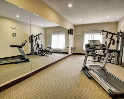 Fitness center with cardio equipment and weights | Comfort Inn And Suites Alvarado