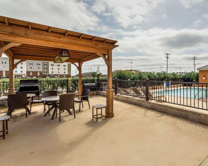 Outdoor pool with sundeck | Comfort Suites Cotulla near I-35
