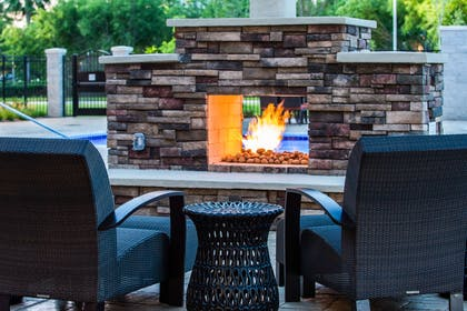 Sit by the hotel's outdoor firepit | Cambria Hotel McAllen Convention Center