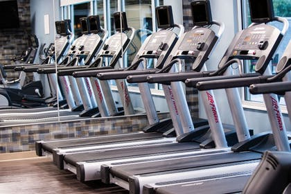 Exercise room with cardio equipment | Cambria Hotel McAllen Convention Center