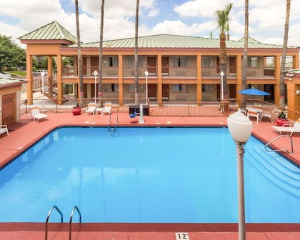 Outdoor pool with sundeck | Econo Lodge Inn & Suites Eagle Pass