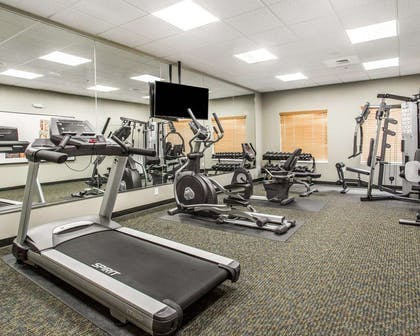Fitness center with cardio equipment | Mainstay Suites