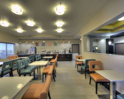 Enjoy breakfast in this seating area | Comfort Inn & Suites Fort Worth West