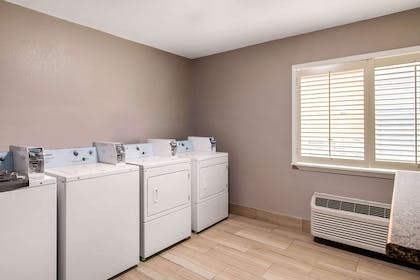 Guest laundry facilities | Quality Inn & Suites Plano East - Richardson