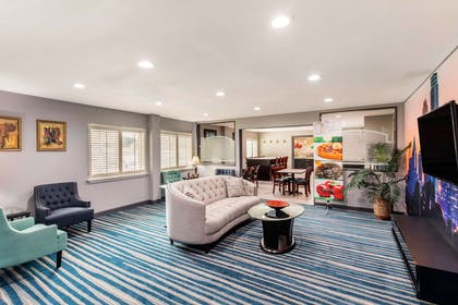 Spacious lobby with sitting area | Quality Inn & Suites Plano East - Richardson