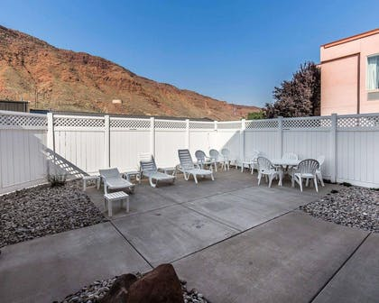 Relax on the hotel patio | Quality Suites