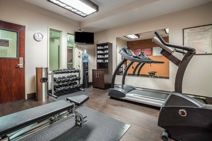 Exercise room | Comfort Suites Airport