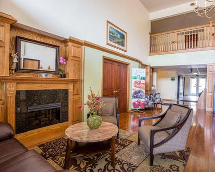 Relax by the fireplace in the lobby | Quality Inn & Suites Airport West