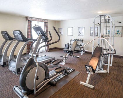 Fitness center with cardio equipment and weights | Comfort Inn Downtown