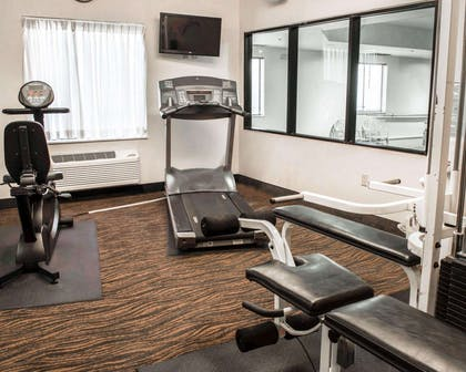 Fitness center with cardio equipment and weights | Sleep Inn & Suites Monticello