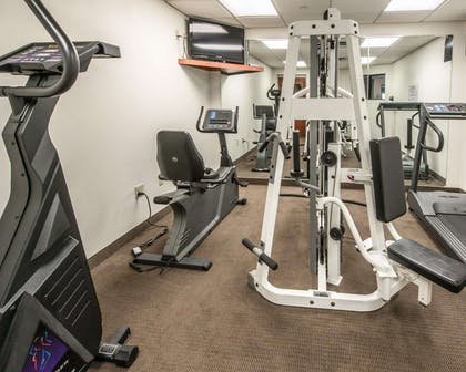 Exercise room with cardio equipment and weights | Sleep Inn & Suites