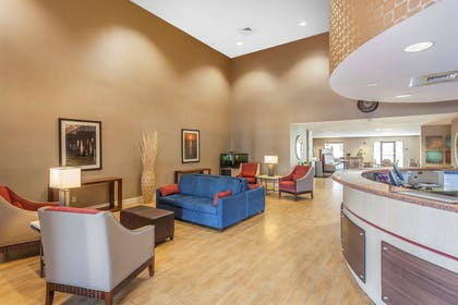 Spacious lobby with sitting area | Comfort Suites Suffolk - Chesapeake
