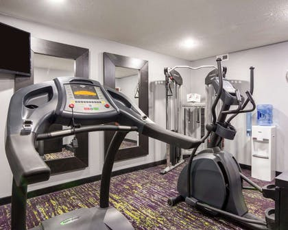 Fitness center with television | Quality Inn & Suites Ashland near Kings Dominion