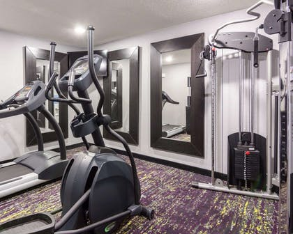 Fitness center with cardio equipment and weights | Quality Inn & Suites Ashland near Kings Dominion