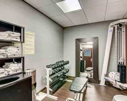 Fitness center with cardio equipment and weights | Comfort Suites Williamsburg Historic Area
