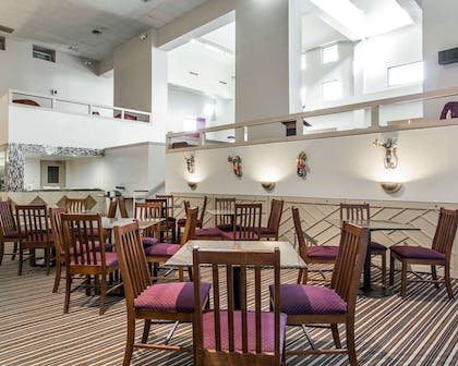 Enjoy breakfast in this seating area | MainStay Suites Williamsburg I-64