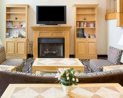 Relax by the fireplace in the lobby | Quality Inn and Suites