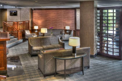 Spacious lobby with sitting area | The Virginian Suites, an Ascend Hotel Collection Member