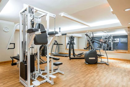 Fitness center with cardio equipment and weights | Comfort Suites South Burlington near University