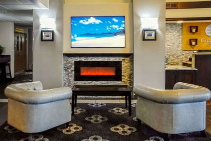 Relax by the fireplace in the lobby | Comfort Inn Kent - Seattle