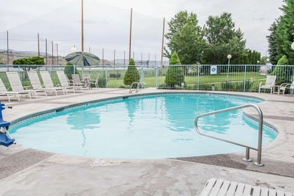 Outdoor pool with hot tub | Quality Inn Conference Center