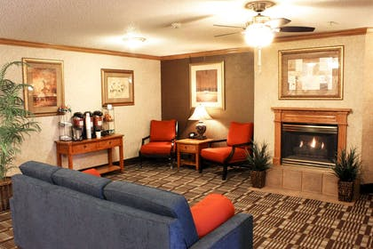 Relax by the fireplace in the lobby | Comfort Inn Central University South