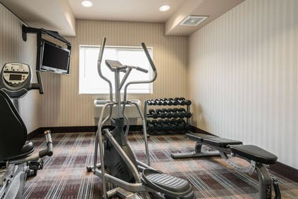 Exercise room with cardio equipment | Quality Inn & Suites at Olympic National Park