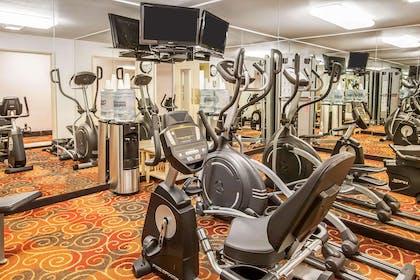 Exercise room with cardio equipment and weights   Quality Inn And Suites Vancouver