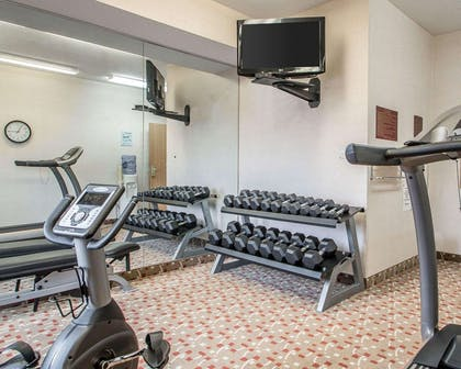 Fitness center with cardio equipment and weights | Sleep Inn & Suites Green Bay South