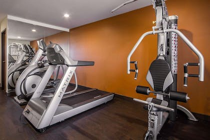 Fitness center with cardio equipment and weights | Comfort Inn