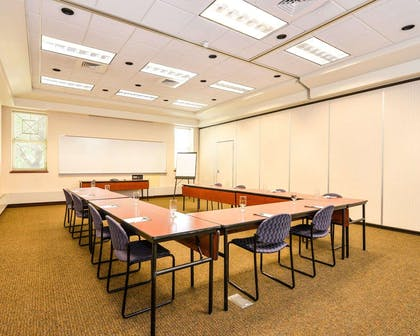 Meeting room with u-shaped setup | Kress Inn, an Ascend Hotel Collection Member