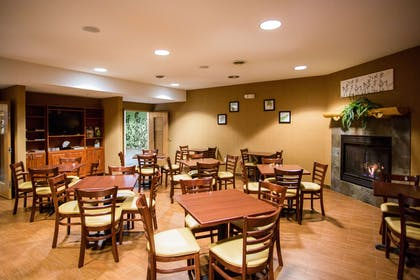Enjoy breakfast in this seating area   Sleep Inn & Suites Conference Center