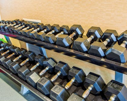 Fitness center with cardio equipment and weights   Cambria Hotel Madison East