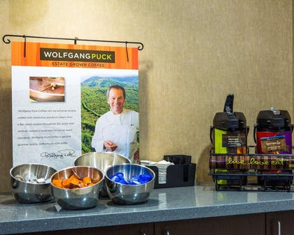 The barista bar serves specialty coffees by Wolfgang Puck   Cambria Hotel Madison East