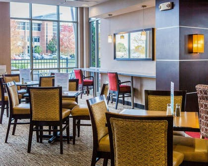 Enjoy breakfast in this seating area | Cambria Hotel Madison East