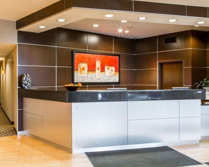 Modern front desk with a helpful and friendly staff | Cambria Hotel Appleton