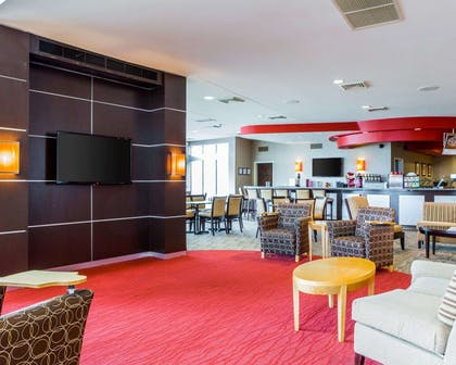 Catch up on the day in front of the large-screen media wall | Cambria Hotel Appleton