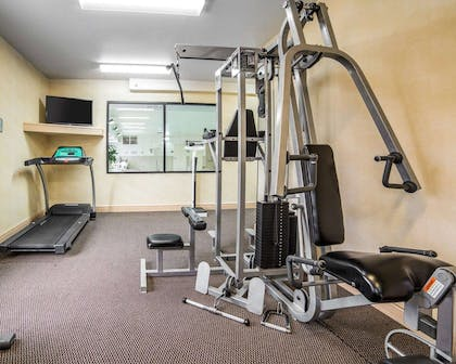 Exercise room with cardio equipment and weights | Comfort Inn & Suites