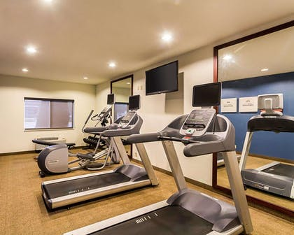 Exercise room with television | Comfort Inn East