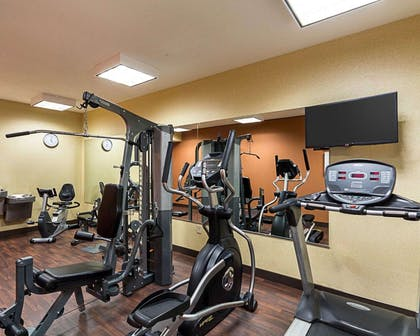 Fitness center with television | Comfort Suites Airport