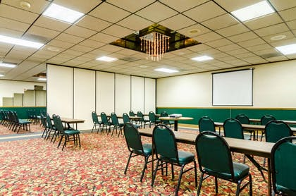 Banquet meeting room with audiovisual equipment   Quality Inn & Suites