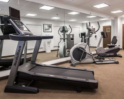 Fitness center with cardio equipment and weights | Sleep Inn And Suites Colby